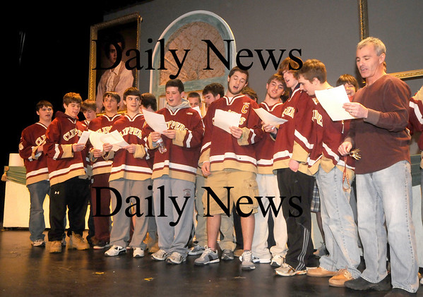 """Newburyport: The Newburyport high hockey team sign the school song """"Alma Marta"""" at a rally at the school Friday. The Team is headed to Boston Garden Sunday to play for a state championship. Jim Vaiknoras/Staff photo"""