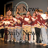 "Newburyport: The Newburyport high hockey team sign the school song ""Alma Marta"" at a rally at the school Friday. The Team is headed to Boston Garden Sunday to play for a state championship. Jim Vaiknoras/Staff photo"