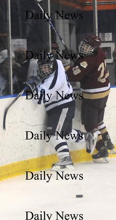 Salem: Newburyport Sean Dillon checks a player agianst Peabody Friday night at Salem State.Jim Vaiknoras/Staff photo