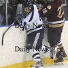 Salem: Newburyport Sean Dillon checks a player agianst Peabody Friday night at Salem State.Jim Vaiknoras/Staff photo