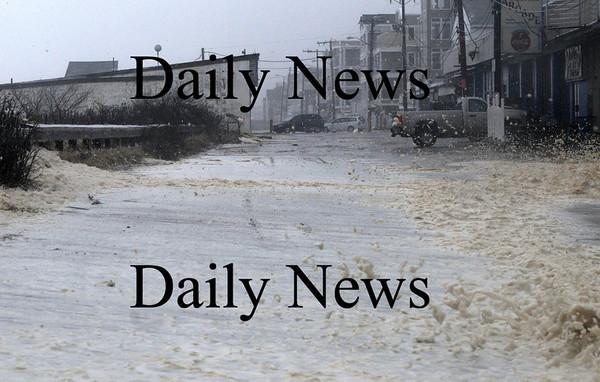Salisbury: Sea foam churned up by Sunday's storm covers Ocean Front Street at Salisbury Beach. Jim Vaiknoras/Staff photo
