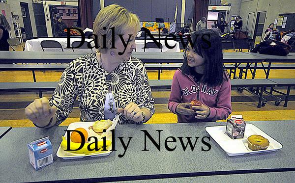 Amesbury: School nurse Joan Connor shares breakfast with 2nd grader Tyda Thepbanthao at the Cashman School in Amesbury. Jim Vaiknoras/Staff photo