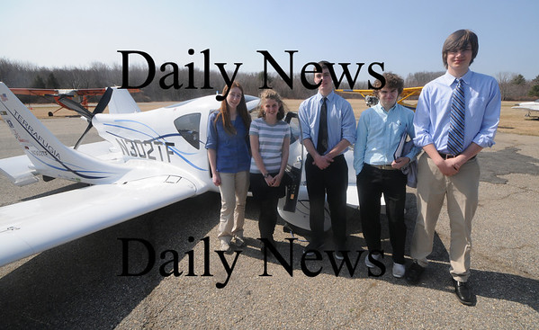 Newburyport; The Newburyport high Real World Design team, Molly Picillo, Belle Dougless, Ryan Campbell, Dan Colby and Connor Graelle pose with the Terrafugia Transition Aircraft at the Plum Island Areodome Fridat.The State Aeronautics Division presented the team with an award for winning the state competition for the second straight year. Jim Vaiknoras/Staff photo