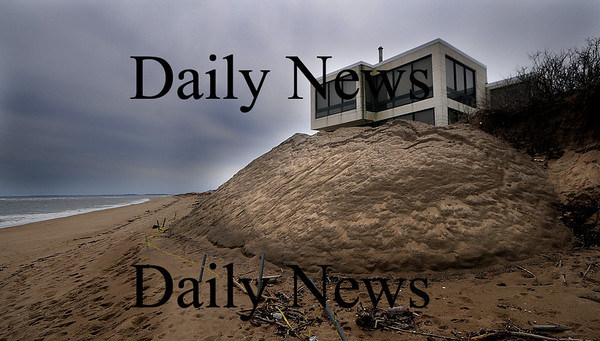Newburyport: Sand piled on the beach in front of a house at the end on 55th Street on teh Newburyport side of Plum Island. Jim Vaiknoras/Staff photo