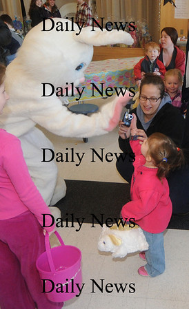 Salisbury: Addison Stanley, 2, and her mom Jill high five the Easter Bunny at the annual Egg Hunt sponsered by the Salisbury parks and Recreation dept at the Elementary School Saturday. Jim Vaiknoras/Staff photo