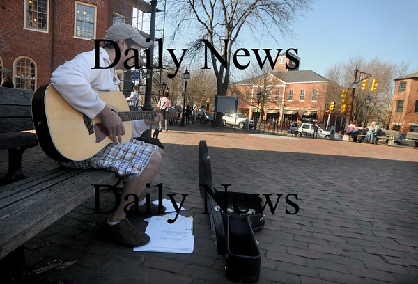 Newburyport: Alex Potenza of Haverhill strums a song on his guitar in Market Square in Newburyport Friday afternoon. Jim Vaiknoras/Staff photo