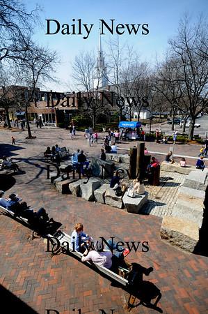 Newburyport: A crowd of people enjoy the warm weather and bright sunshine Saturday on Inn Street in Newburyport
