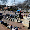 Newburyport: A crowd of people enjoy the warm weather and bright sunshine Saturday on Inn Street in Newburyport