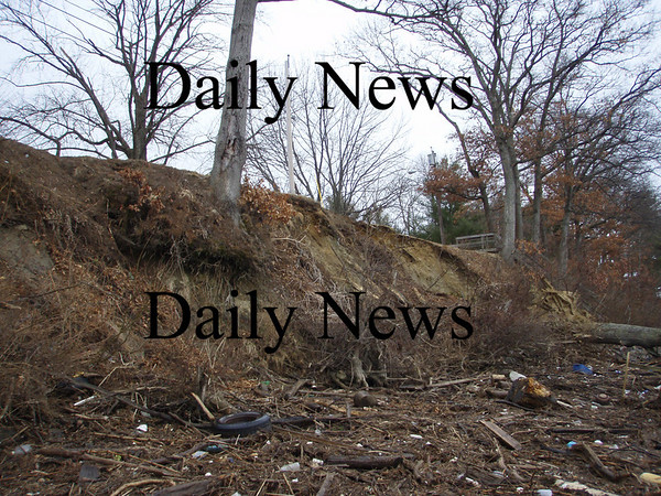 A section of eroding riverbank along the Merrimack River bank next to Pleasant Valley Road in Amesbury could cost up to $1 million to fix. This picture was taken earlier this week, and officials say the erosion has worsened with each tide.
