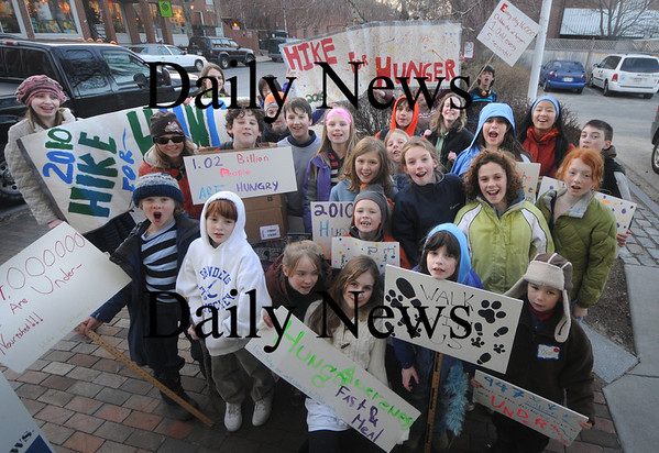 Newburyport: A group of students from the River Valley Charter School in Newburyport pose for a photo on Liberty Street in Newburyport during their Hunger Hike Friday night. Jim Vaiknoras/Staff photo