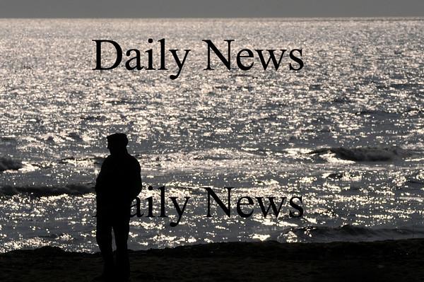 Salisbury: Barry Norton of Lowell walks along Salsibury Beach early Sunday morning. Jim Vaiknoras/Staff photo