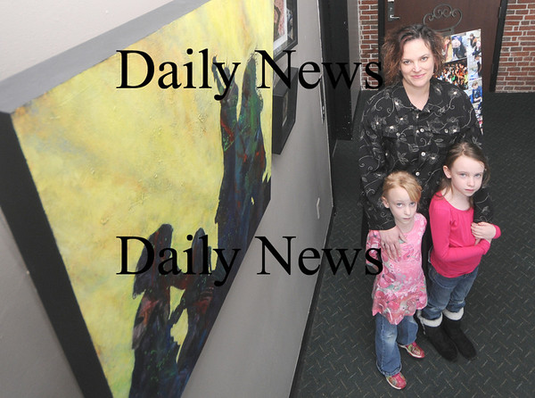 """Newburyport: Artist Lisa Riordon with her daughters Emma, 9, and Sadie, 6, at her show, """" A Painting a Day for Haiti's Children"""" at the Firehouse in newburyport. Jim Vaiknoras/Staff photo"""