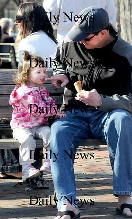 Newburyport: Bill Joor shares gelato with his daughter Nina, 2, in Market Square in Newburyport Friday. Jim Vaiknoras/Staff photo