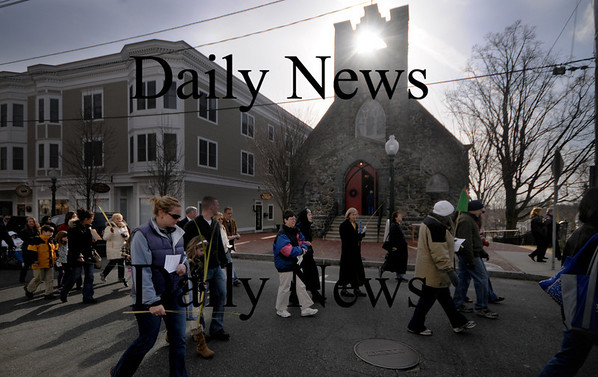Amesbury: The annual Amesbury Psalm Sunday precession makes it's way past St. James Episcopal Church in Amesbury Sunday. The event sponcored by the Council of Churched started at the Millyard and stopped at churched along the way ending at teh All Saints church. Jim Vaiknoras/Staff photo