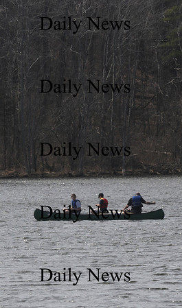 West Newbury: Three fishermen glide along Mill Pond in WestNewbury Saturday morning. Jim Vaiknoras/Staff photo