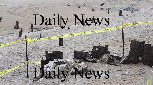 Salisbury: The foundation of some old building on Salisbury Beach that had been long covered with sand are exposed by resent erosion. Jim Vaiknoras/Staff photo