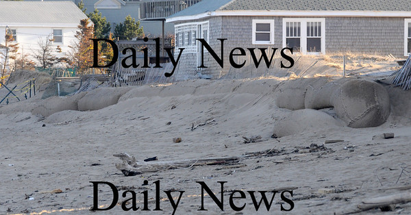 Newbury: Sand brought up by surf cover large sand bags put up on Plum Ilsand to protect home from erosion. Jim Vaiknoras/Staff photo