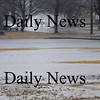 Newbury:  The Upper Green in Newbury is flooded Sunday afternoon with rain puddles connecting with the skating pond covering most of the green with water. Jim Vaiknoras/Staff photo