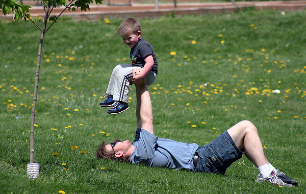 Amesbury: Troy Mudgett of Haverhil plays with his son, Jake, 3, Tuesday morning at the Amesbury Town Park. Photo by Ben Laing/Staff Photo