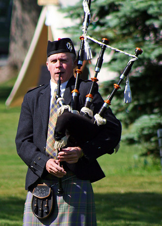 Newbury: A bagpiper plays a tune on the Upper Green in Newbury Saturday morning, as festivities were being held for the town's 375th anniversary. Photo by Ben Laing/Staff Photo
