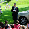 Amesbury: Lillian Eaton, a World War II veteran and member of the Amesbury American Legion, speaks to some first and second graders at the Veteran's Cemetary in Amesbury Tuesday morning. The children were replacing American flags at all the veteran's gravesites. Photo by Ben Laing/Staff Photo