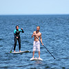 Newbury: A couple of paddle boarders roam the shore off of Plum Island Monday afternoon. Photo by Ben Laing/Staff Photo