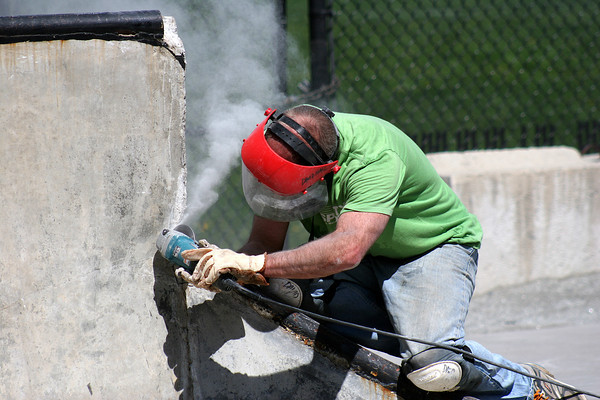 Newburyport: Workers repair damage to the concrete at the Newburyport Skate Park Wednesday afternoon, preparing it for the influx of skaters as the weather improves. Photo by Ben Laing/Staff Photo