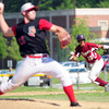 Amesbury: Newburyport's Drew Carter begins his move to second base as Amesbury pitcher, Sean Ward (12) begins his delivery during Tuesday afternoon's game. Photo by Ben Laing/Staff Photo