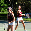 Newburyport: Newburyport's Carlina Arango lines up a volley with her doubles partner Lindsey Ayotte patroling the net during Tuesday afternoon's game against Wilmington at Atkinson Common. Photo by Ben Laing/Staff Photo