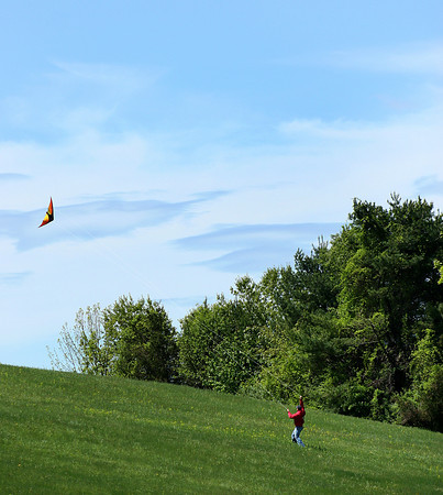 Amesbury: Monday morning saw a perfect opputunity for kite flying at Woodsom Farm in Amesbury, as this man takes advantage of the breezy weather. Photo by Ben Laing/Staff Photo