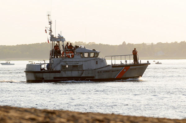 Newburyport: A United States Coast Guard vessel patrols the waters off of Plum Island point Tuesday evening searching for a missing swimmer. Photo by Ben Laing/Staff Photo