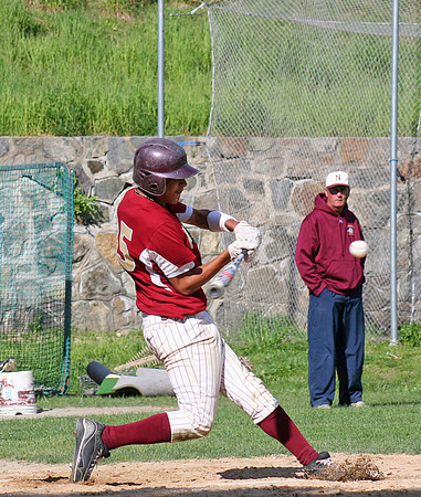 Newburyport: Newburyport's Drew Carter (15) makes contact with a pitch during Monday afternoon's game against Lynnfield at NHS. Photo by Ben Laing/Staff Photo