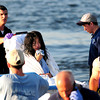 Newburyport: EMT's transport a swimmer who was pulled from the waters at Plum Island point Tuesday afternoon. She was one of seven rescued by private boaters before emergency personel arrived on scene. Photo by Ben Laing/Staff Photo