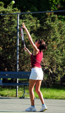 Newburyport: Carlina Arango sets up a serve Tuesday afternoon as Newburyport hosted Wilmington. Photo by Ben Laing/Staff Photo