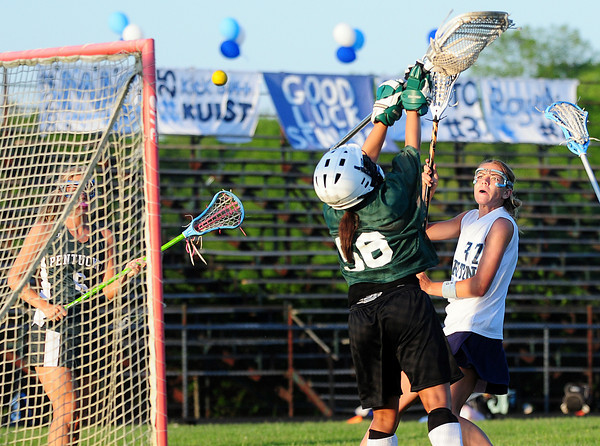 Byfield: Triton's Jen Rock (37) lobs a shot over Pentucket goalie Hillary Dandurant (56) during Monday night's game in Byfield. Photo by Ben Laing/Staff Photo