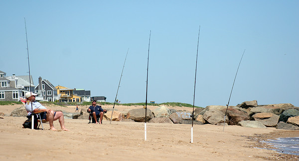 Newbury: A new Federal law requiring salt water fishermen to acquire a permit goes into effect soon. The law will impact surf casters like these men on Plum Island Monday afternoon. Photo by Ben Laing/Staff Photo