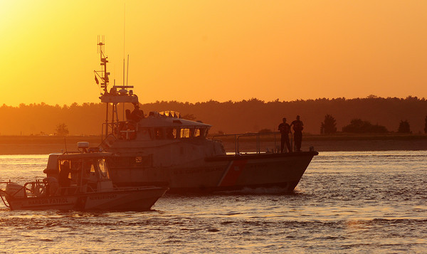 Newburyport: The United State Coast Guard and the Newburyport Harbormaster search the waters off of Plum Island point for a missing swimmer Tuesday evening. Photo by Ben Laing/Staff Photo