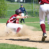 Newburyport: Newburyport's shortstop Brett Fontaine (6) slides safely into home plate during the first inning of Monday's game against Lynnfield. Photo by Ben Laing/Staff Photo