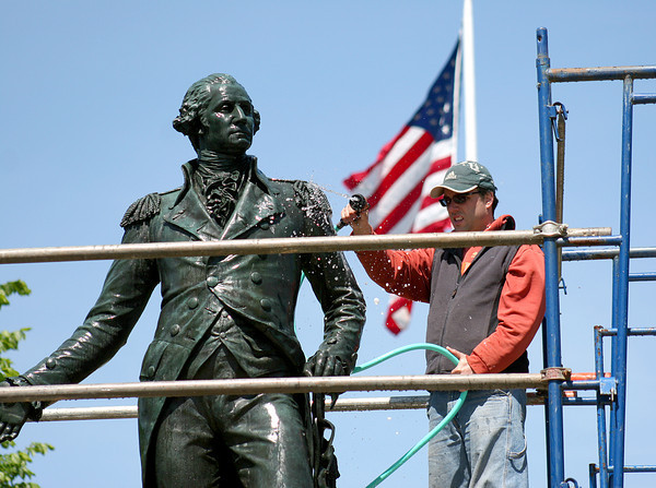 Newburyport: George Washington's statue at the intersection of Pond and High Streets, receives a cleaning from Will Kerr Tuesday morning. Photo by Ben Laing/Staff Photo