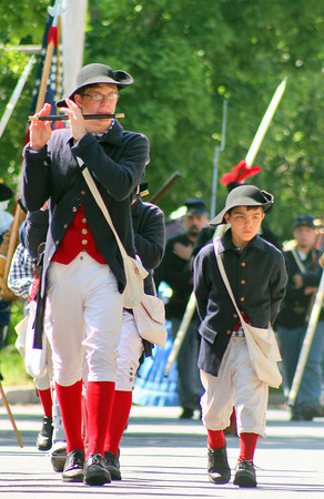 Newbury: Members of a fife and drum corps march along High Road in Newbury, from the Upper Green to the First Parish Church, Saturday morning, as festivities honoring the town's 375th anniversary were being held. Photo by Ben Laing/Staff Photo
