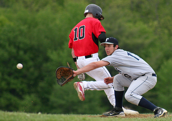 Byfield: Triton first baseman, (10) looks the ball into his glove during an attempted pick off of a North Andover baserunner at Tuesday's game in Byfield. Photo by Ben Laing/Staff Photo