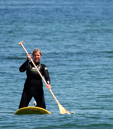 Salisbury: A paddleboarder cruises in the waters off of Salisbury Beach during a beautiful Monday afternoon. Photo by Ben Laing/Staff Photo