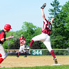 Amesbury: Newburyport first baseman John Isabel (19) stretches for a high throw but managed to keep one foot on the bag, securing the out before an Amesbury batter could reach the base. Photo by Ben Laing/Staff Photo