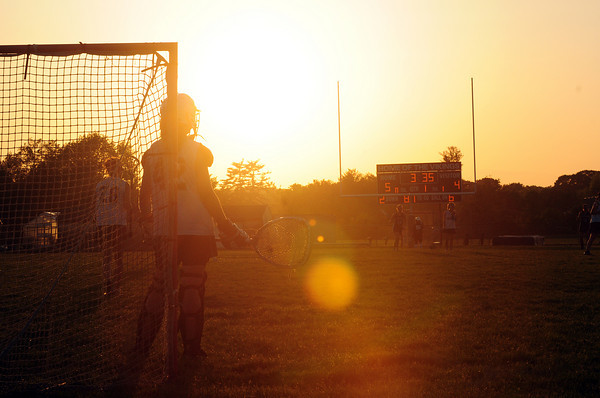 Byfield: The sun sets over the field at Triton High School as the Vikings played host to the Pentucket girls lacrosse team Monday night. Photo by Ben Laing/Staff Photo