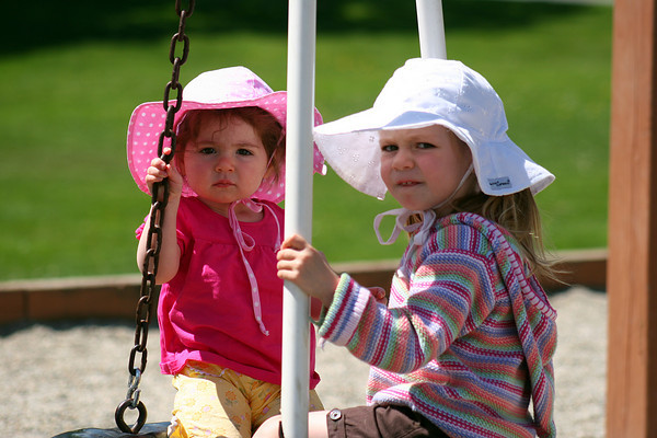 Amesbury: Megan Kelly, left and her sister Jenna, spend Monday morning on the swings at the Amesbury Town Park. Photo by Ben Laing/Staff Photo