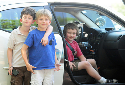 Newburyport: Brendan Howland, left, Nicholas Petty, center, and Cian Magauran, right, won a contest at the Montessori School that had them deputized by a Newburyport police officer and given a ride in a police cruiser. Photo by Ben Laing/Staff Photo