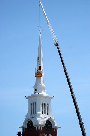 Newburyport: Workers install cellular antennas inside the steeple at the Central Congregational Church on Titcomb Street Monday morning. Photo by Ben Laing/Staff Photo