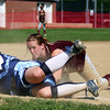 Byfield: Newburyport third baseman Rachel Notargiacomo (7) dives back to the bag in time to tag out a Triton baserunner, completing an unassisted double play in Monday afternoon's game in Byfield. Photo by Ben Laing/Staff Photo