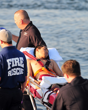 Newburyport: EMT's transport a swimmer who was pulled from the waters at Plum Island point Tuesday afternoon. He was one of seven rescued by private boaters before emergency personel arrived on scene. Photo by Ben Laing/Staff Photo