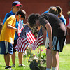 Amesbury: Elementary school students place American flags at the graves of veterans at the Amesbury Veteran's Cemetery Tuesday morning in preperation for Memorial Day next week. Photo by Ben Laing/Staff Photo